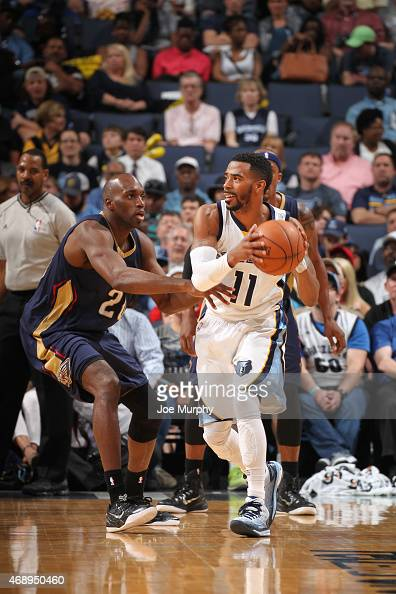 Mike Conley of the Memphis Grizzlies defends the ball against Quincy Pondexter of the New Orleans Pelicans during the game on April 8 2015 at...