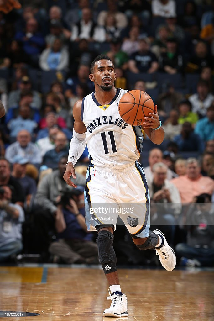 Mike Conley #11 of the Memphis Grizzlies dribbles the ball against the Boston Celtics on November 4, 2013 at FedExForum in Memphis, Tennessee.