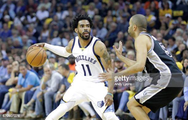 Mike Conley of the Memphis Grizzlies dribbles the ball against the San Antonio Spurs in game three of the Western Conference Quarterfinals during the...