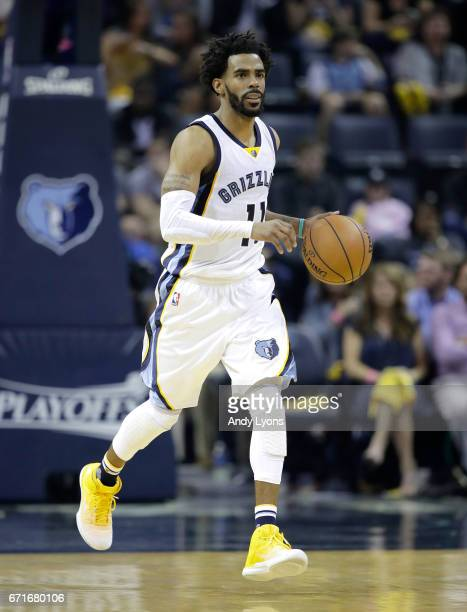 Mike Conley of the Memphis Grizzlies dribbles the ball against the San Antonio Spurs in game four of the Western Conference Quarterfinals during the...