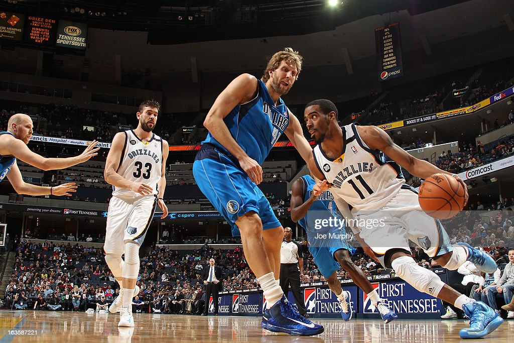 Mike Conley #11 of the Memphis Grizzlies drives against <a gi-track='captionPersonalityLinkClicked' href=/galleries/search?phrase=Dirk+Nowitzki&family=editorial&specificpeople=201490 ng-click='$event.stopPropagation()'>Dirk Nowitzki</a> #41 of the Dallas Mavericks on February 27, 2013 at FedExForum in Memphis, Tennessee.