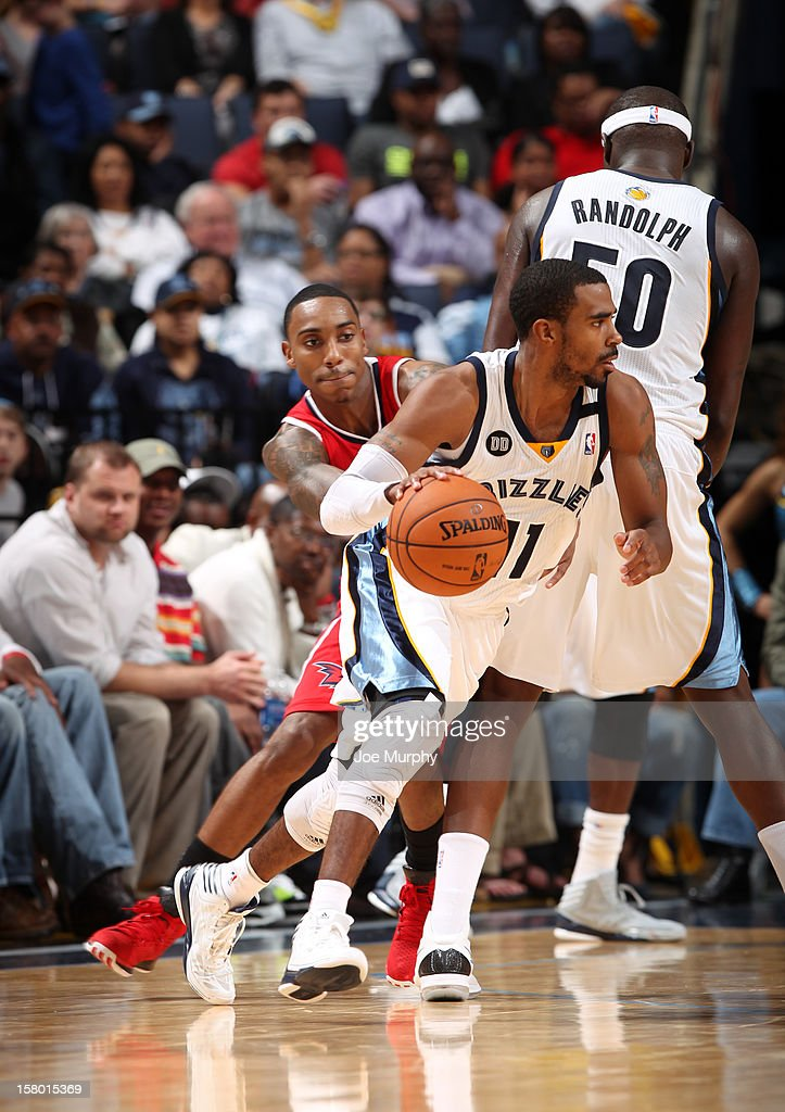 MIke Conley #11 of the Memphis Grizzlies drives against <a gi-track='captionPersonalityLinkClicked' href=/galleries/search?phrase=Jeff+Teague&family=editorial&specificpeople=4680498 ng-click='$event.stopPropagation()'>Jeff Teague</a> #0 of the Atlanta Hawks on December 8, 2012 at FedExForum in Memphis, Tennessee.