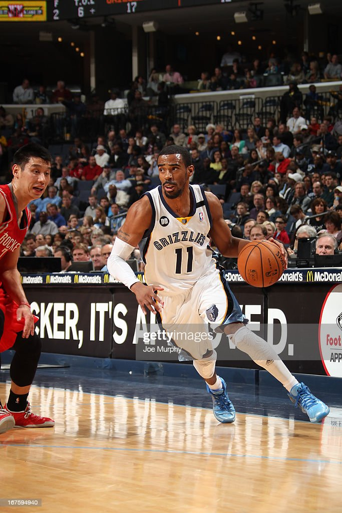 Mike Conley #11 of the Memphis Grizzlies drives against <a gi-track='captionPersonalityLinkClicked' href=/galleries/search?phrase=Jeremy+Lin&family=editorial&specificpeople=6669516 ng-click='$event.stopPropagation()'>Jeremy Lin</a> #7 of the Houston Rockets on March 29, 2013 at FedExForum in Memphis, Tennessee.
