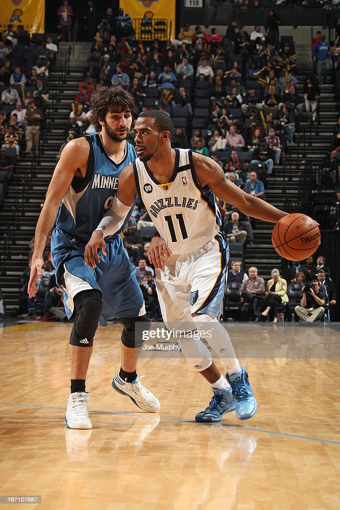 Mike Conley #11 of the Memphis Grizzlies drives against <a gi-track='captionPersonalityLinkClicked' href=/galleries/search?phrase=Ricky+Rubio&family=editorial&specificpeople=4028920 ng-click='$event.stopPropagation()'>Ricky Rubio</a> #9 of the Minnesota Timberwolves on March 18, 2013 at FedExForum in Memphis, Tennessee.