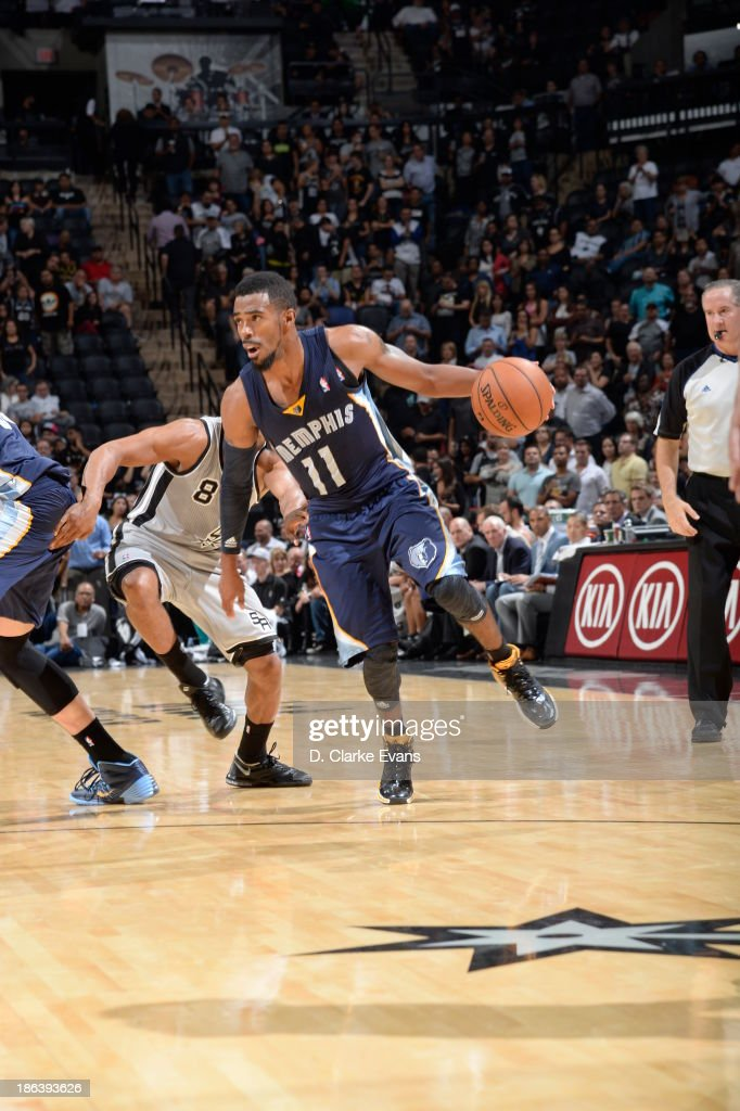Mike Conley #11 of the Memphis Grizzlies drives against the San Antonio Spurs at the AT&T Center on October 30, 2013 in San Antonio, Texas.