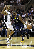 Mike Conley of the Memphis Grizzlies drives against Tony Parker of the San Antionio Spurs in Game Five of the Western Conference Quarterfinals in the...