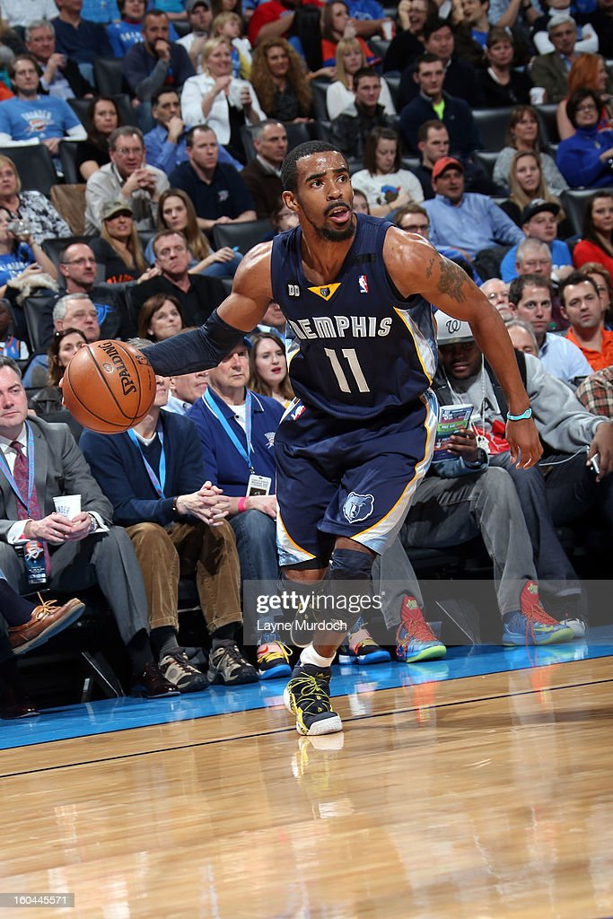 Mike Conley #11 of the Memphis Grizzlies drives baseline against the Oklahoma City Thunder during an NBA game on January 31, 2013 at the Chesapeake Energy Arena in Oklahoma City, Oklahoma.