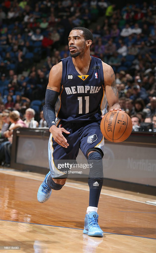 Mike Conley #11 of the Memphis Grizzlies drives during the game between the Memphis Grizzlies and the Minnesota Timberwolves on March 30, 2013 at Target Center in Minneapolis, Minnesota.
