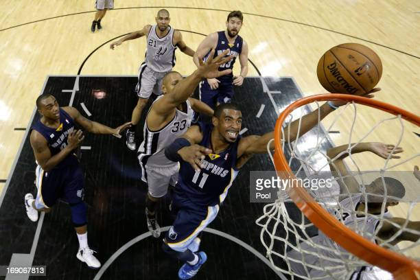 Mike Conley of the Memphis Grizzlies drives for a shot attempt in the first half against Boris Diaw of the San Antonio Spurs during Game One of the...