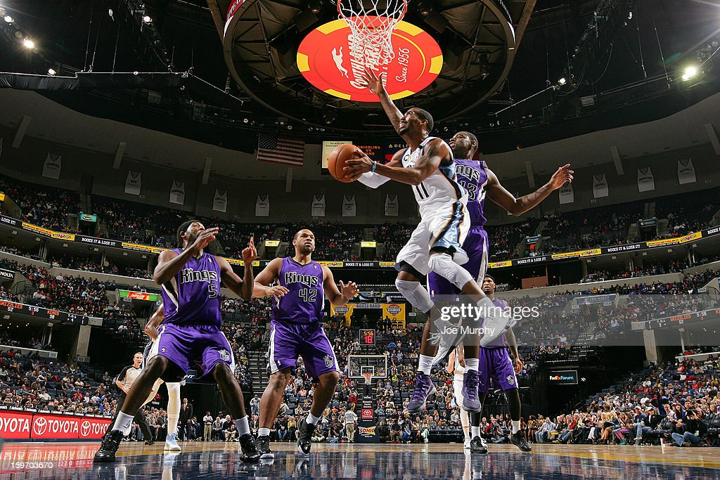 Mike Conley #11 of the Memphis Grizzlies drives to the basket against <a gi-track='captionPersonalityLinkClicked' href=/galleries/search?phrase=Tyreke+Evans&family=editorial&specificpeople=4851025 ng-click='$event.stopPropagation()'>Tyreke Evans</a> #13 of the Sacramento Kings on January 18, 2013 at FedExForum in Memphis, Tennessee.