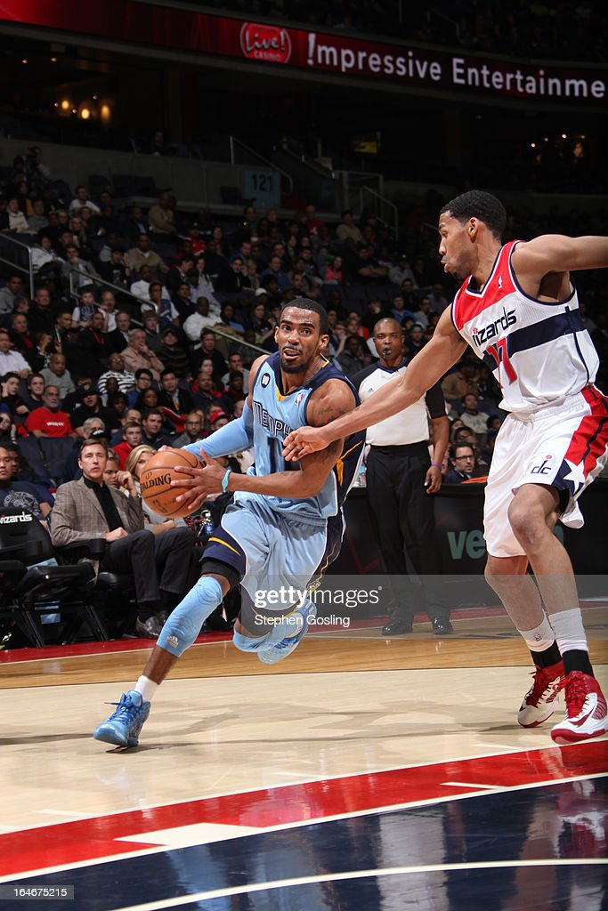 Mike Conley #11 of the Memphis Grizzlies drives to the basket against <a gi-track='captionPersonalityLinkClicked' href=/galleries/search?phrase=Garrett+Temple&family=editorial&specificpeople=709398 ng-click='$event.stopPropagation()'>Garrett Temple</a> #17 of the Washington Wizards at the Verizon Center on March 25, 2013 in Washington, DC.
