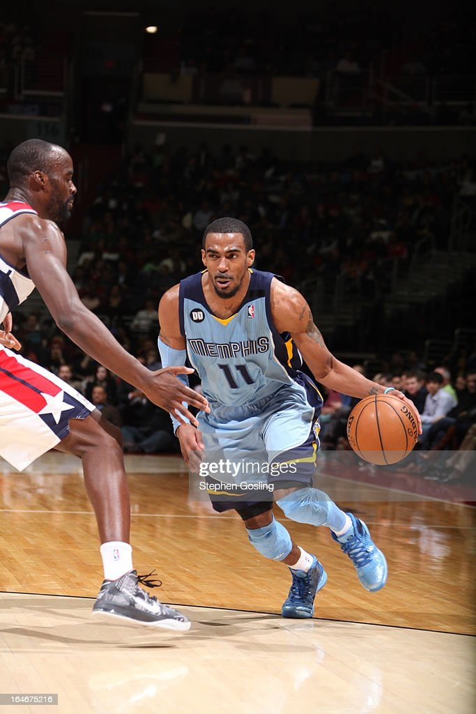 Mike Conley #11 of the Memphis Grizzlies drives to the basket against <a gi-track='captionPersonalityLinkClicked' href=/galleries/search?phrase=Emeka+Okafor&family=editorial&specificpeople=201739 ng-click='$event.stopPropagation()'>Emeka Okafor</a> #50 of the Washington Wizards at the Verizon Center on March 25, 2013 in Washington, DC.