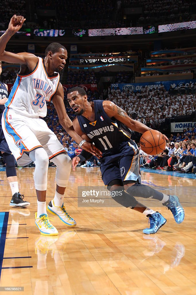 Mike Conley #11 of the Memphis Grizzlies drives to the basket against <a gi-track='captionPersonalityLinkClicked' href=/galleries/search?phrase=Kevin+Durant&family=editorial&specificpeople=3847329 ng-click='$event.stopPropagation()'>Kevin Durant</a> #35 of the Oklahoma City Thunder in Game Two of the Western Conference Semifinals during the 2013 NBA Playoffs on May 7, 2013 at the Chesapeake Energy Arena in Oklahoma City, Oklahoma.