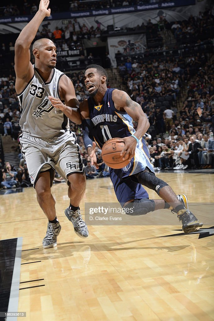 Mike Conley #11 of the Memphis Grizzlies drives to the basket against <a gi-track='captionPersonalityLinkClicked' href=/galleries/search?phrase=Boris+Diaw&family=editorial&specificpeople=201505 ng-click='$event.stopPropagation()'>Boris Diaw</a> #33 of the San Antonio Spurs at the AT&T Center on October 30, 2013 in San Antonio, Texas.