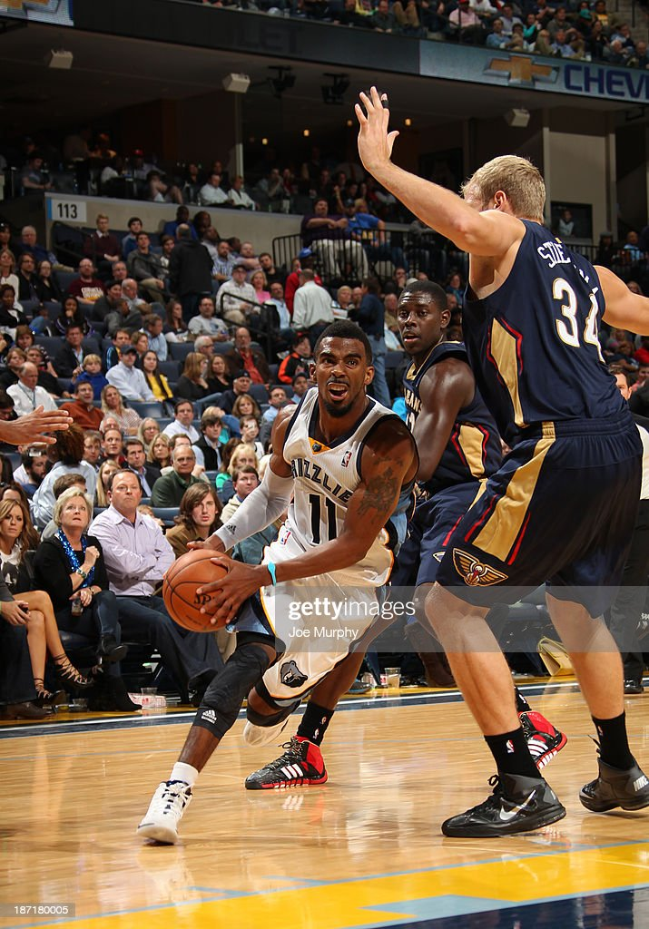Mike Conley of the Memphis Grizzlies drives to the basket against Greg Stiemsma of the New Orleans Pelicans on November 6 2013 at FedExForum in...