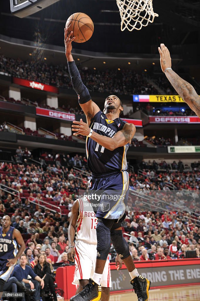 Mike Conley #11 of the Memphis Grizzlies drives to the basket against the Houston Rockets on December 22, 2012 at the Toyota Center in Houston, Texas.