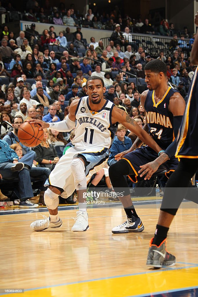 Mike Conley #11 of the Memphis Grizzlies drives to the basket against the Indiana Pacers on January 21, 2013 at FedExForum in Memphis, Tennessee.