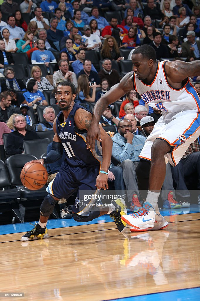 Mike Conley #11 of the Memphis Grizzlies drives to the basket against the Oklahoma City Thunder on January 31, 2013 at the Chesapeake Energy Arena in Oklahoma City, Oklahoma.