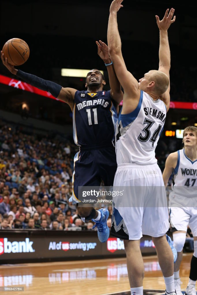 Mike Conley #11 of the Memphis Grizzlies drives to the basket against the Minnesota Timberwolves on March 30, 2013 at Target Center in Minneapolis, Minnesota.