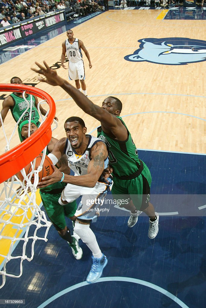 Mike Conley #11 of the Memphis Grizzlies drives to the basket against the Boston Celtics on March 23, 2013 at FedExForum in Memphis, Tennessee.
