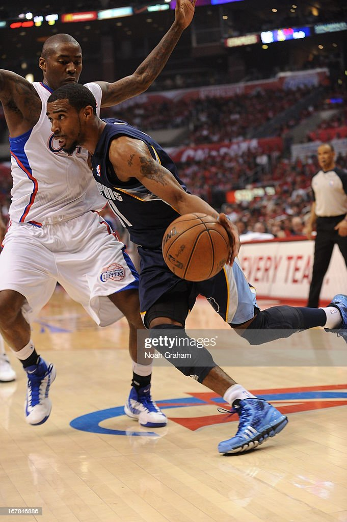 Mike Conley #11 of the Memphis Grizzlies drives to the basket against the Los Angeles Clippers at Staples Center in Game Five of the Western Conference Quarterfinals during the 2013 NBA Playoffs on April 30, 2013 in Los Angeles, California.