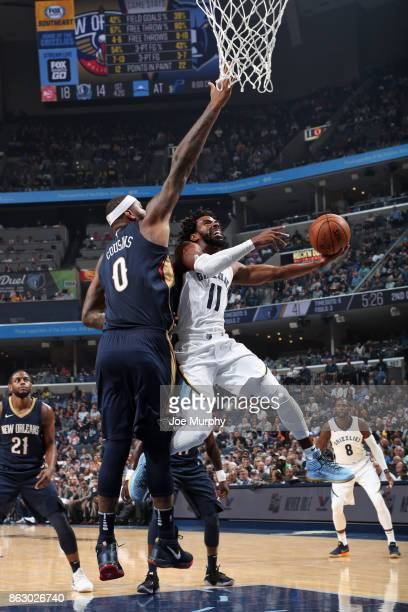 Mike Conley of the Memphis Grizzlies drives to the basket against the New Orleans Pelicans during the 201718 regular season game on October 18 2017...