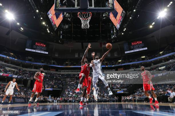Mike Conley of the Memphis Grizzlies drives to the basket during a preseason game against the Houston Rockets on October 11 2017 at FedExForum in...
