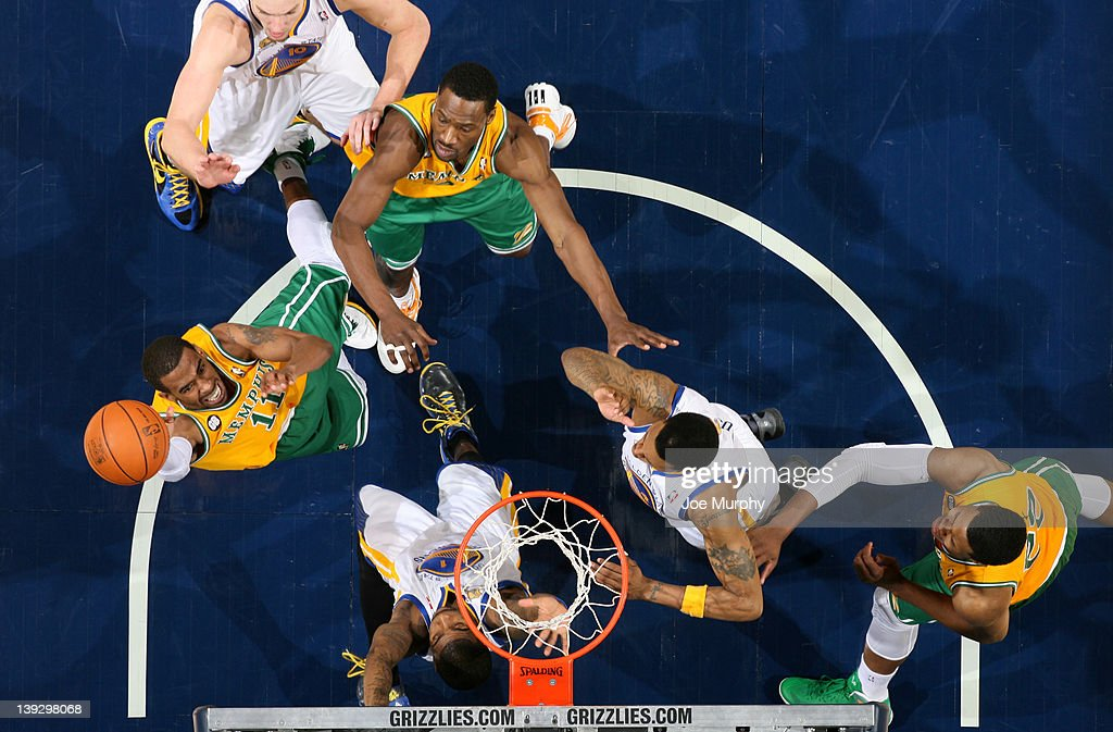 Mike Conley #11 of the Memphis Grizzlies drives to the basket for a layup against <a gi-track='captionPersonalityLinkClicked' href=/galleries/search?phrase=Dorell+Wright&family=editorial&specificpeople=211344 ng-click='$event.stopPropagation()'>Dorell Wright</a> #1 of the Golden State Warriors on February 18, 2012 at FedExForum in Memphis, Tennessee.