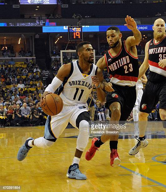 Mike Conley of the Memphis Grizzlies drives toward Allen Crabbe of the Portland Trailblazers in the first quarter of Game One of the first round of...
