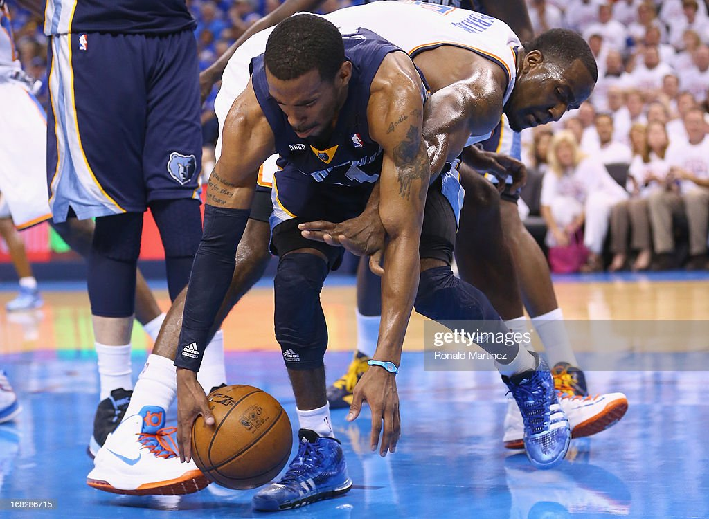 Mike Conley #11 of the Memphis Grizzlies gets a loose ball against Kendrick Perkins #5 of the Oklahoma City Thunder during Game Two of the Western Conference Semifinals of the 2013 NBA Playoffs at Chesapeake Energy Arena on May 7, 2013 in Oklahoma City, Oklahoma.