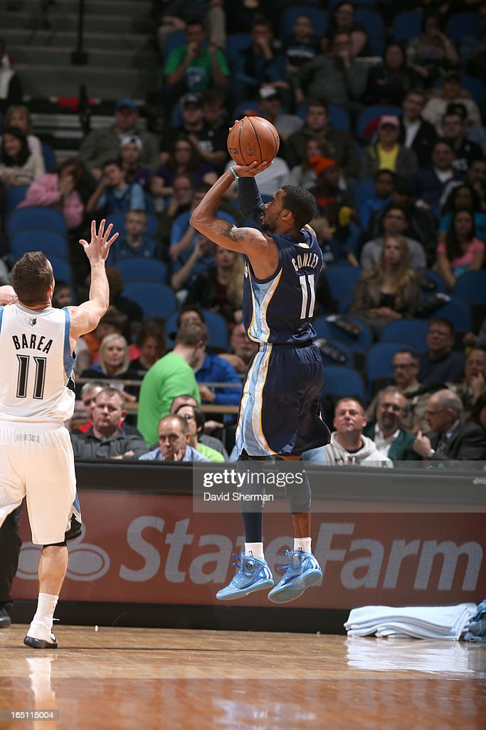 Mike Conley #11 of the Memphis Grizzlies goes for a jump shot during the game between the Memphis Grizzlies and the Minnesota Timberwolves on March 30, 2013 at Target Center in Minneapolis, Minnesota.