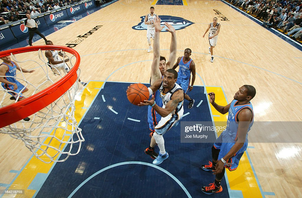Mike Conley #11 of the Memphis Grizzlies goes to the basket against <a gi-track='captionPersonalityLinkClicked' href=/galleries/search?phrase=Nick+Collison&family=editorial&specificpeople=202843 ng-click='$event.stopPropagation()'>Nick Collison</a> #4 of the Oklahoma City Thunder on March 20, 2013 at FedExForum in Memphis, Tennessee.