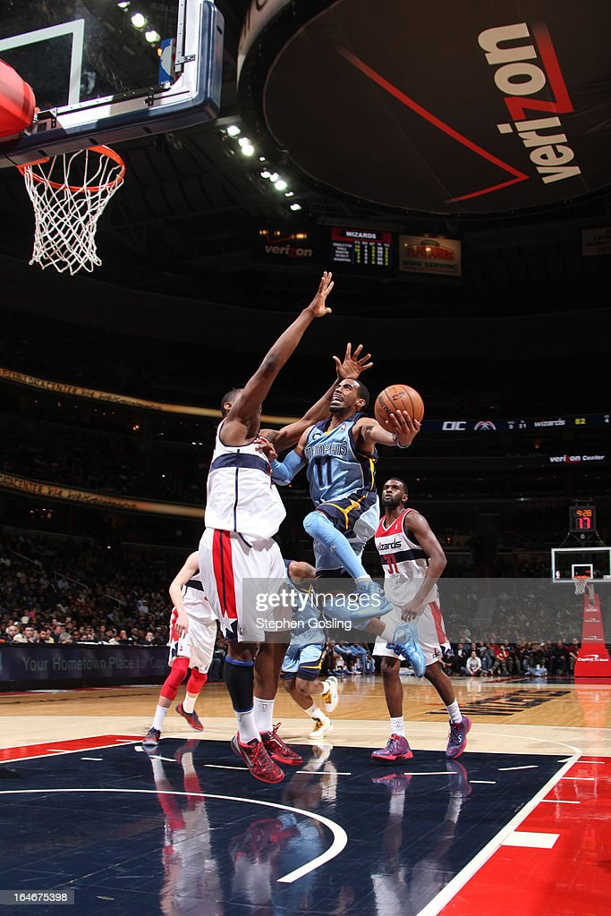 Mike Conley #11 of the Memphis Grizzlies goes to the basket against the Washington Wizards at the Verizon Center on March 25, 2013 in Washington, DC.