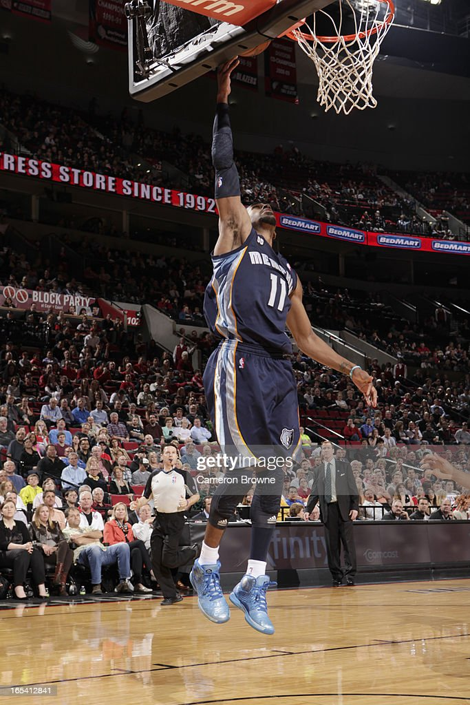 Mike Conley #11 of the Memphis Grizzlies goes to the basket during the game between the Memphis Grizzlies and the Portland Trail Blazers on April 3, 2013 at the Rose Garden Arena in Portland, Oregon.