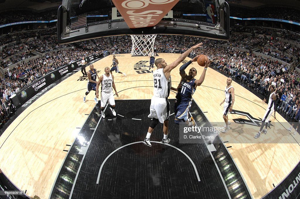 Mike Conley #11 of the Memphis Grizzlies goes to the basket <a gi-track='captionPersonalityLinkClicked' href=/galleries/search?phrase=Tim+Duncan&family=editorial&specificpeople=201467 ng-click='$event.stopPropagation()'>Tim Duncan</a> #21 of the San Antonio Spurs on January 16, 2013 at the AT&T Center in San Antonio, Texas.