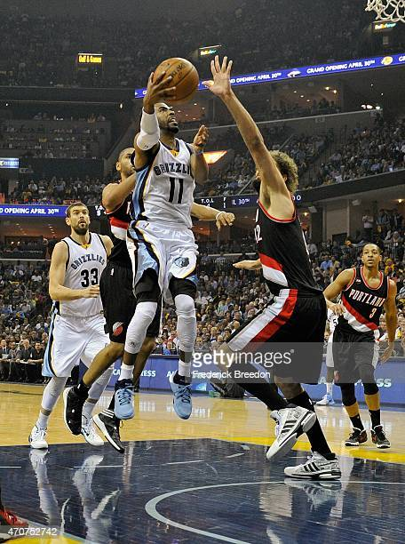 Mike Conley of the Memphis Grizzlies goes up for a shot over Robin Lopez of the Portland Trailblazers during the first half of Game Two of the first...