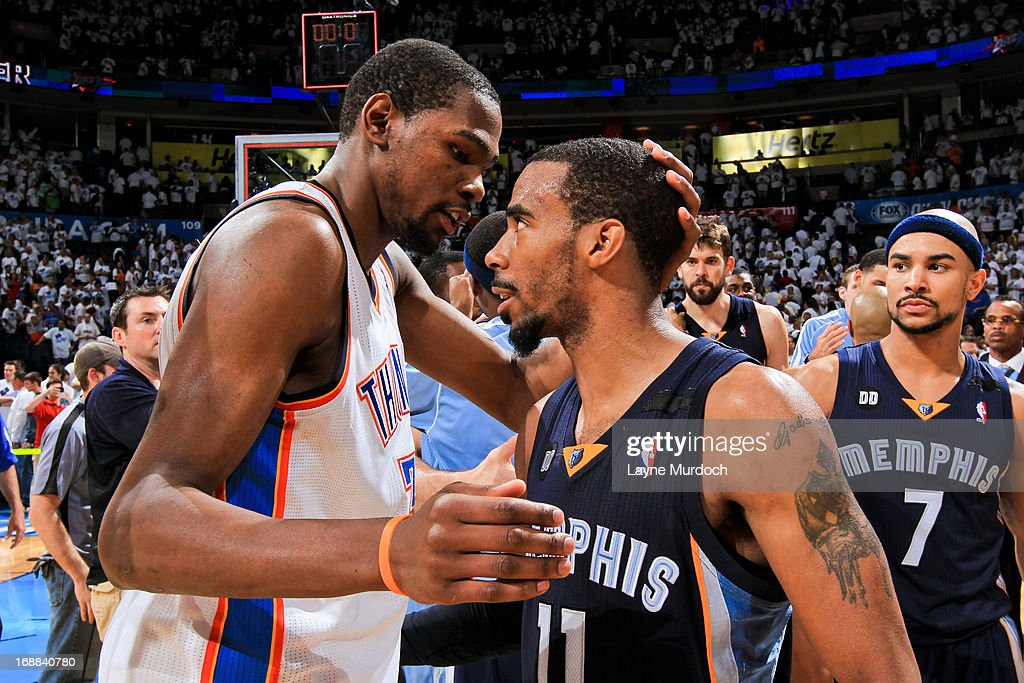 Mike Conley #11 of the Memphis Grizzlies greets Kevin Durant #35 of the Oklahoma City Thunder following his team's series win against the Thunder in Game Five of the Western Conference Semifinals during the 2013 NBA Playoffs on May 15, 2013 at the Chesapeake Energy Arena in Oklahoma City, Oklahoma.