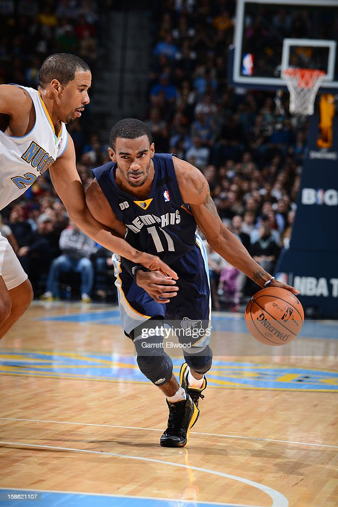 Mike Conley #11 of the Memphis Grizzlies handles the ball against <a gi-track='captionPersonalityLinkClicked' href=/galleries/search?phrase=Andre+Miller&family=editorial&specificpeople=201678 ng-click='$event.stopPropagation()'>Andre Miller</a> #24 of the Denver Nuggets on December 14, 2012 at the Pepsi Center in Denver, Colorado.