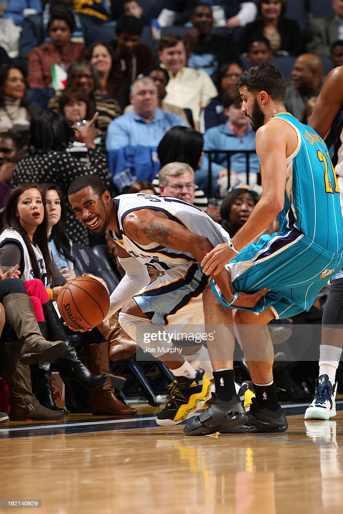 Mike Conley #11 of the Memphis Grizzlies handles the ball against <a gi-track='captionPersonalityLinkClicked' href=/galleries/search?phrase=Greivis+Vasquez&family=editorial&specificpeople=4066977 ng-click='$event.stopPropagation()'>Greivis Vasquez</a> #21 of the New Orleans Hornets on January 27, 2013 at FedExForum in Memphis, Tennessee.