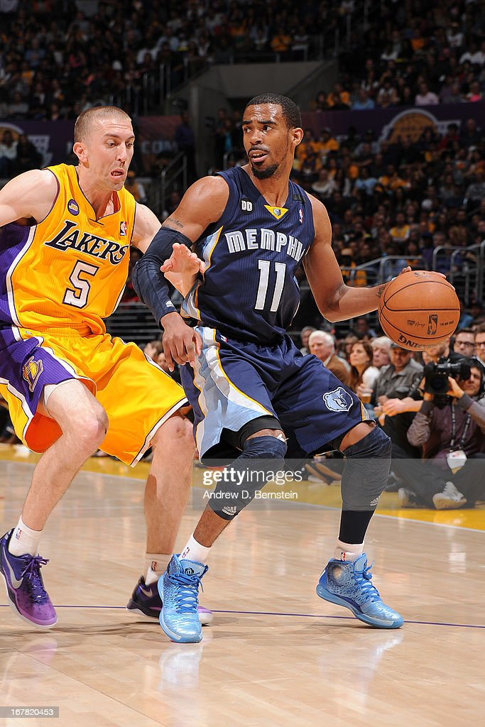 Mike Conley #11 of the Memphis Grizzlies handles the ball against <a gi-track='captionPersonalityLinkClicked' href=/galleries/search?phrase=Steve+Blake+-+Basketball+Player&family=editorial&specificpeople=204474 ng-click='$event.stopPropagation()'>Steve Blake</a> #5 of the Los Angeles Lakers at Staples Center on April 5, 2013 in Los Angeles, California.