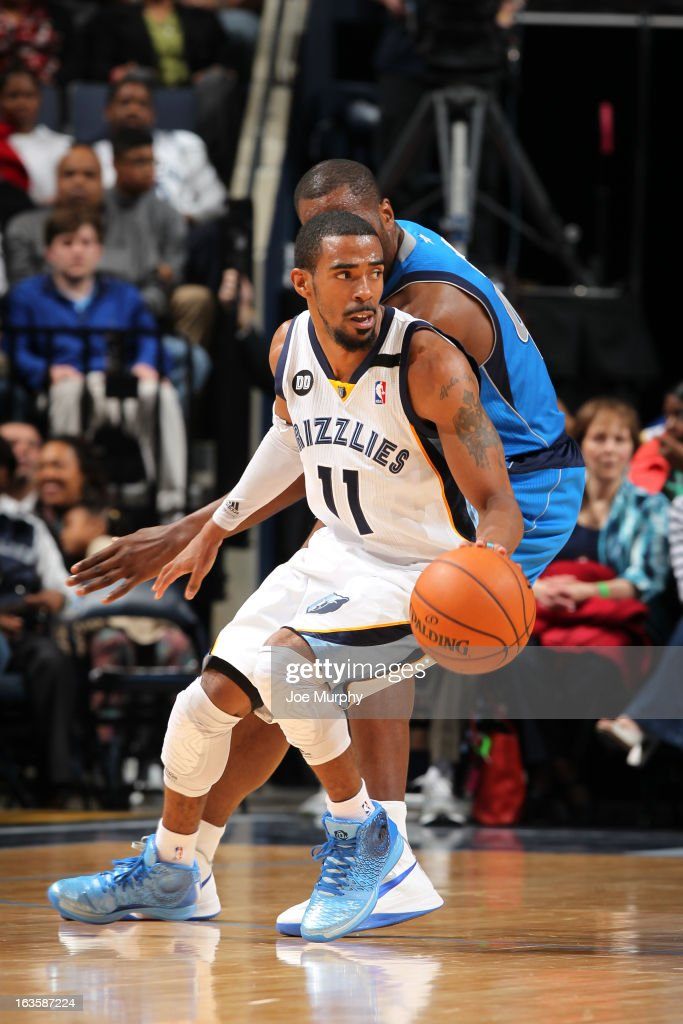 Mike Conley #11 of the Memphis Grizzlies handles the ball against the Dallas Mavericks on February 27, 2013 at FedExForum in Memphis, Tennessee.