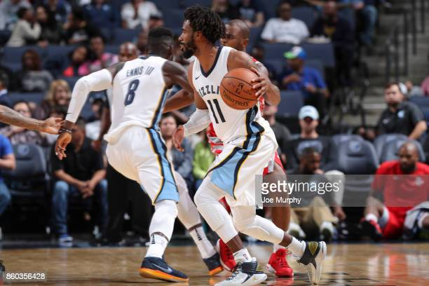 Mike Conley of the Memphis Grizzlies handles the ball during a preseason game against the Houston Rockets on October 11 2017 at FedExForum in Memphis...