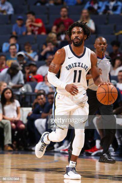 Mike Conley of the Memphis Grizzlies handles the ball during a preseason game against the New Orleans Pelicans on October 13 2017 at FedExForum in...