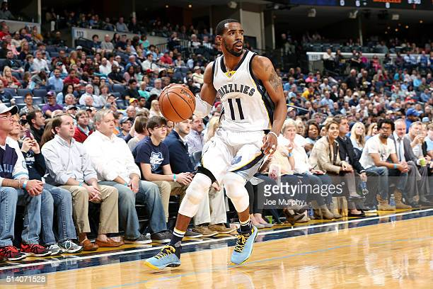 Mike Conley of the Memphis Grizzlies handles the ball during the game against the Phoenix Suns on March 6 2016 at FedExForum in Memphis Tennessee...