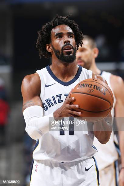 Mike Conley of the Memphis Grizzlies handles the ball during the 201718 regular season game against the New Orleans Pelicans on October 18 2017 at...