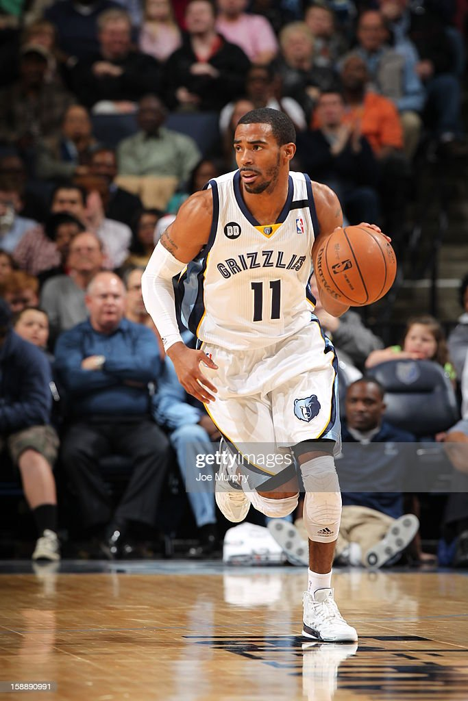 Mike Conley #11 of the Memphis Grizzlies handles the ball up-court against the Dallas Mavericks on December 21, 2012 at FedExForum in Memphis, Tennessee.