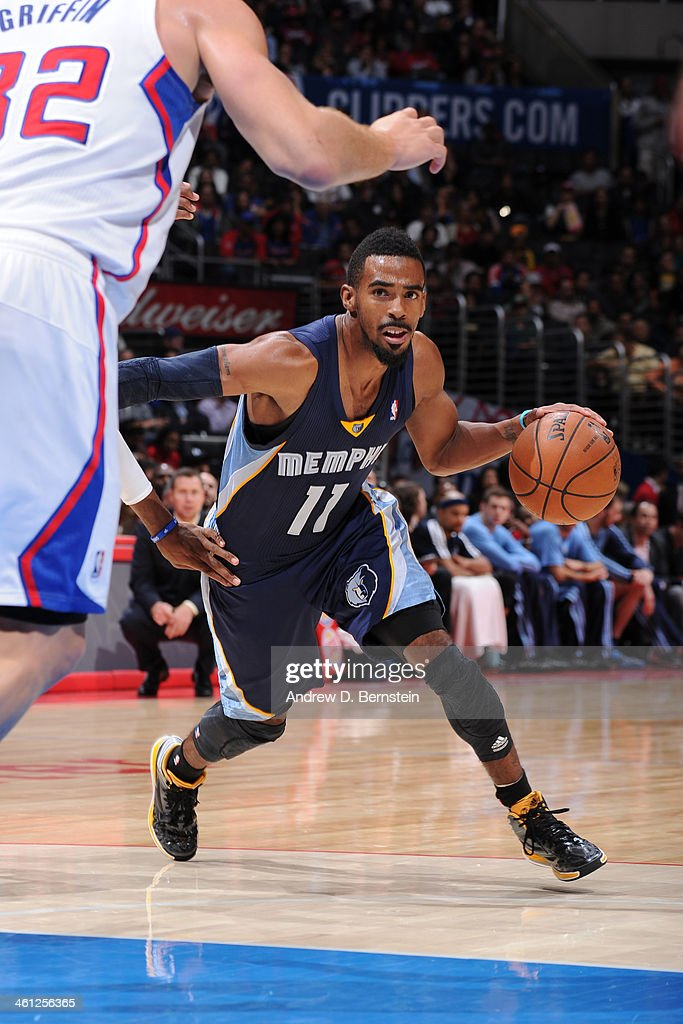 Mike Conley #11 of the Memphis Grizzlies looking to make a move in a game against the Los Angeles Clippers at Staples Center on November 18, 2013 in Los Angeles, California.