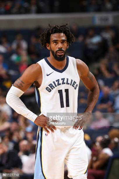 Mike Conley of the Memphis Grizzlies looks on during a preseason game against the New Orleans Pelicans on October 13 2017 at FedExForum in Memphis...