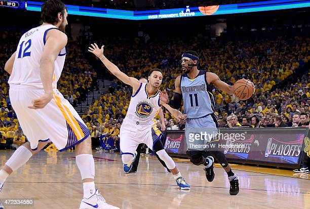 Mike Conley of the Memphis Grizzlies looks to dribble past Stephen Curry of the Golden State Warriors in the first quarter of Game Two of the Western...