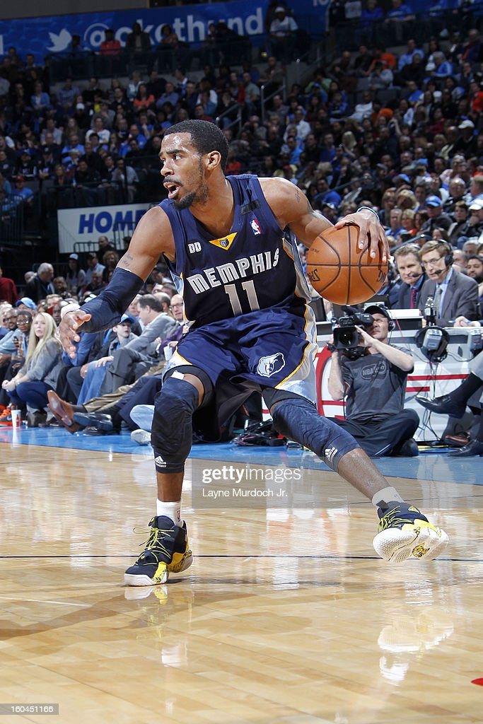 Mike Conley #11 of the Memphis Grizzlies looks to pass the ball against the Oklahoma City Thunder during an NBA game on January 31, 2013 at the Chesapeake Energy Arena in Oklahoma City, Oklahoma.